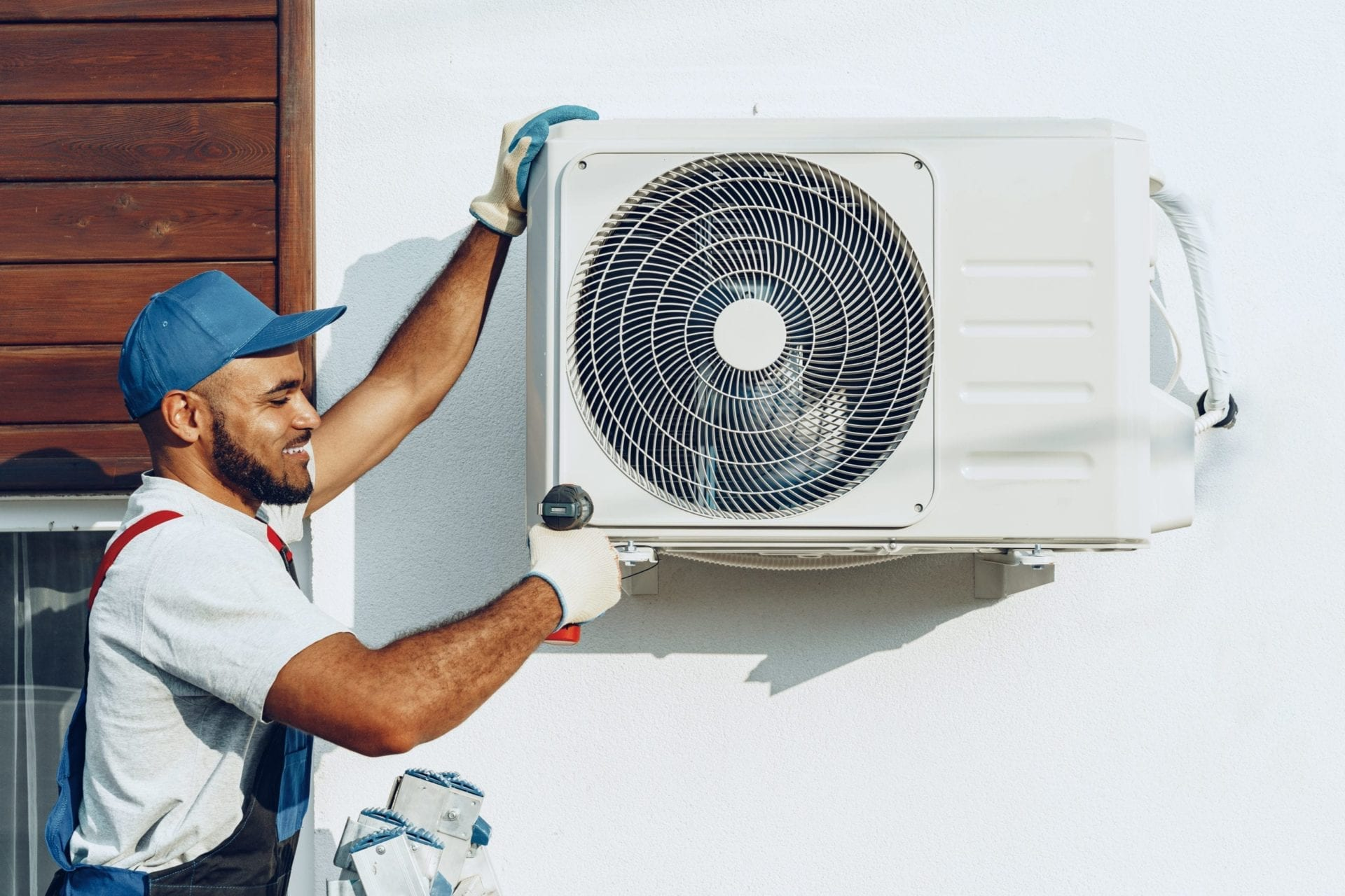 Hand press on remote control of Air Conditioning.